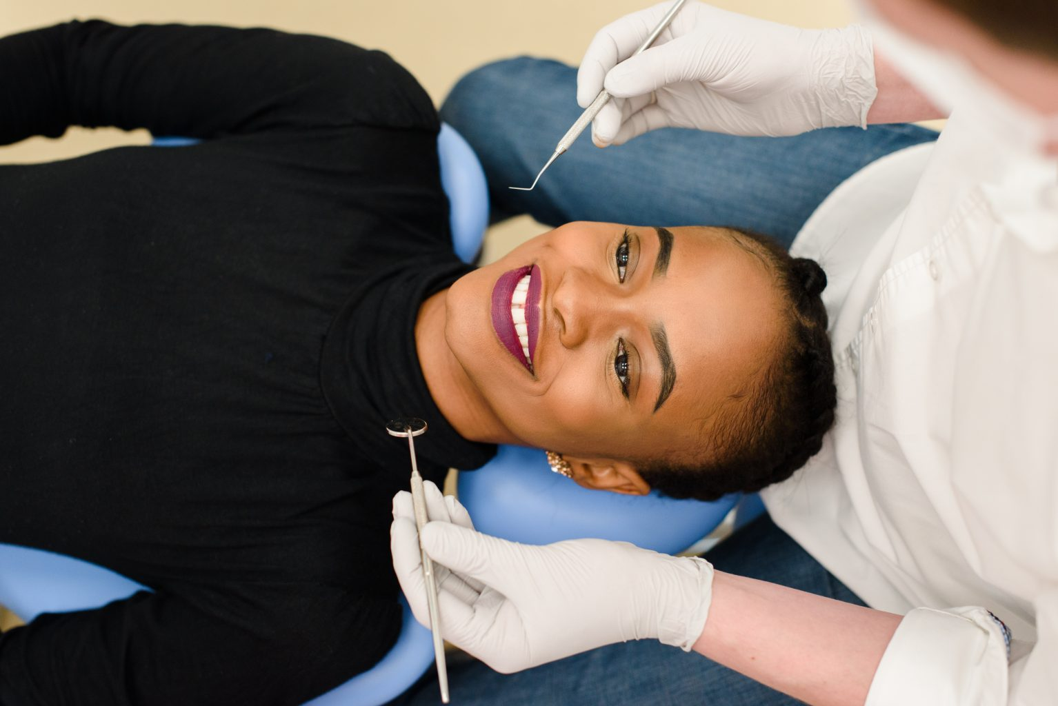 Young African American Ethnic Black Female Smiling While Dentist In White Latex Gloves Check Condition Of Her Teeth