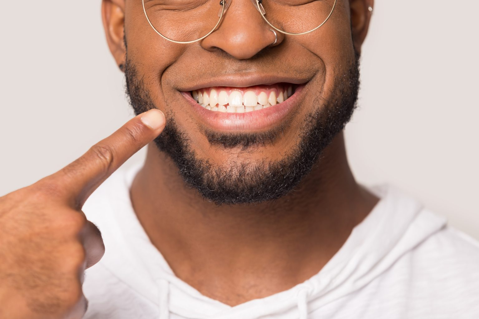 Close Up Of Biracial Man Show White Healthy Teeth