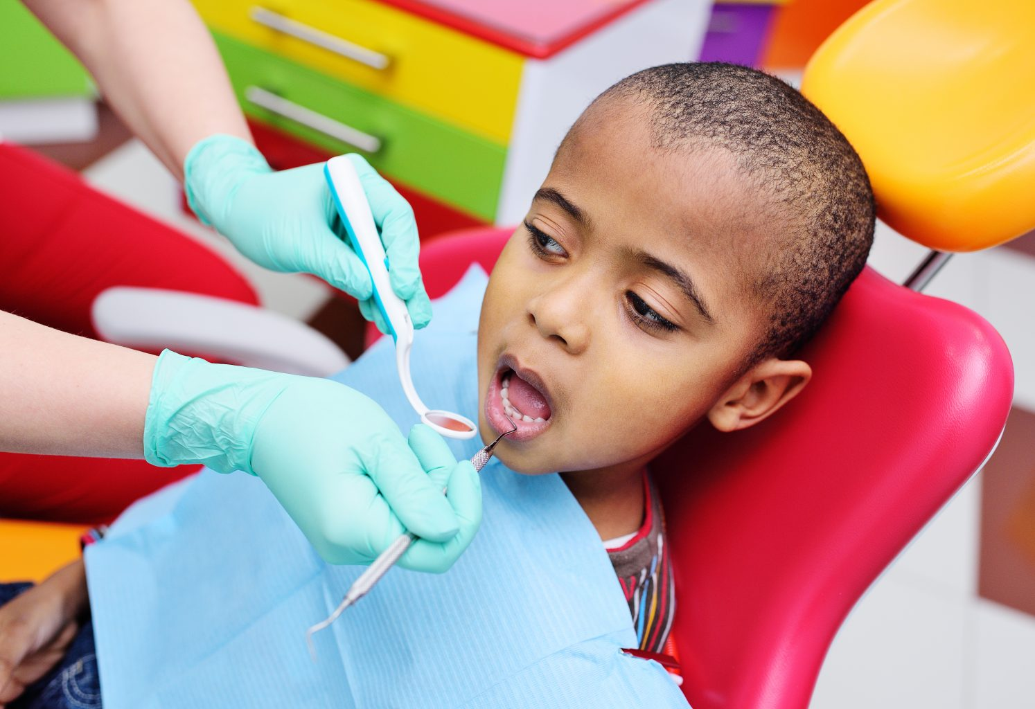 Cute Black Baby Boy African American Smiling Sitting In The Dental Chair